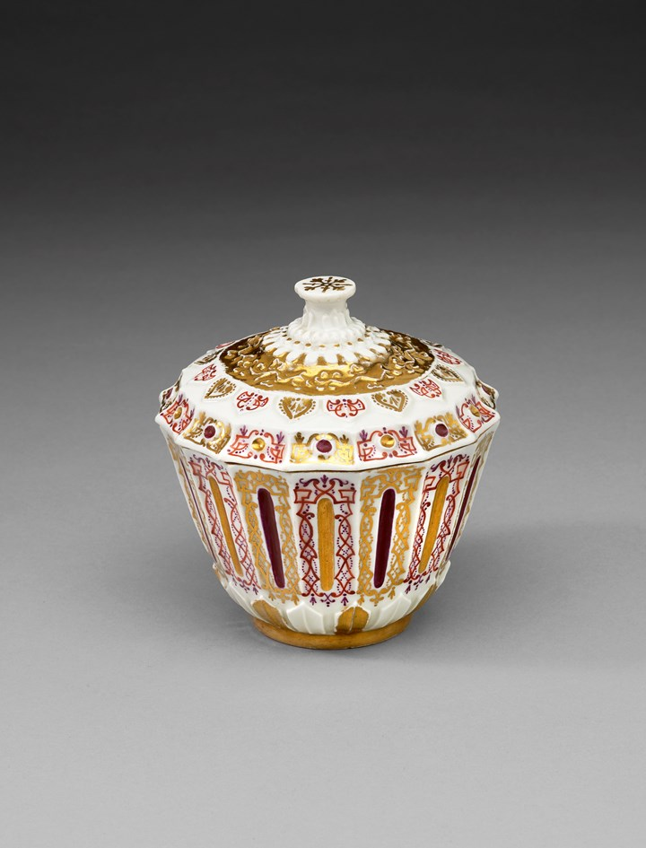 A covered sugar bowl with relief decoration