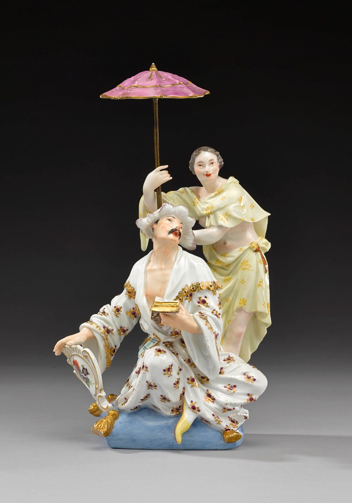 A group of figures of a Japanese couple