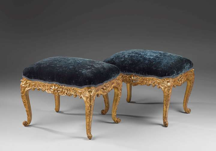 A pair of carved and giltwood Régence tabourets