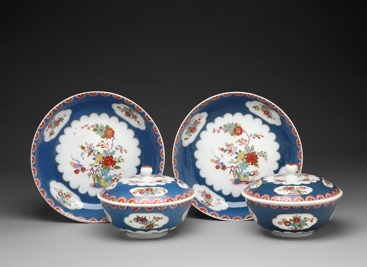 A pair of covered tureens and stands with enamel blue ground and floral decoration in the style of the Sakaida Kakiemon manufactory