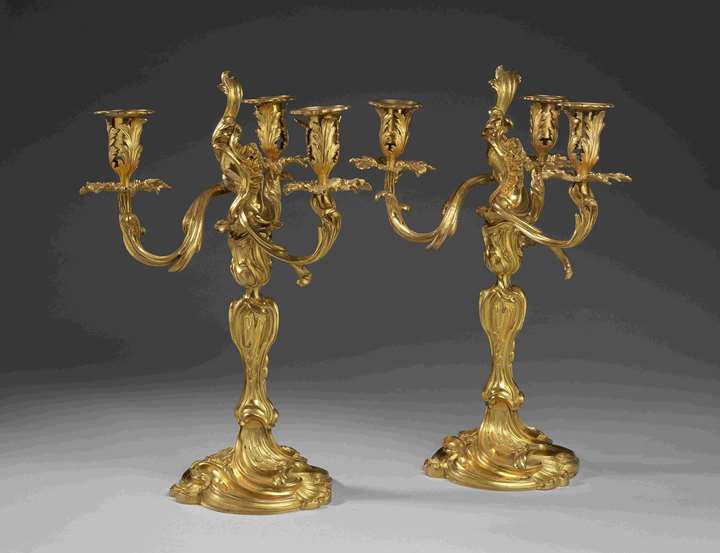 A pair of gilt bronze three branch candelabra (girandoles)