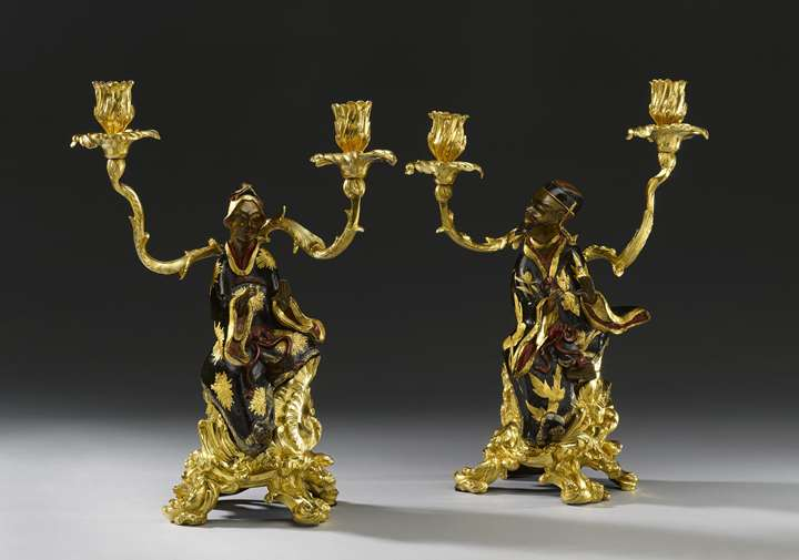 A pair of lacquered bronze Chinese figures  mounted as twin-branch candelabra