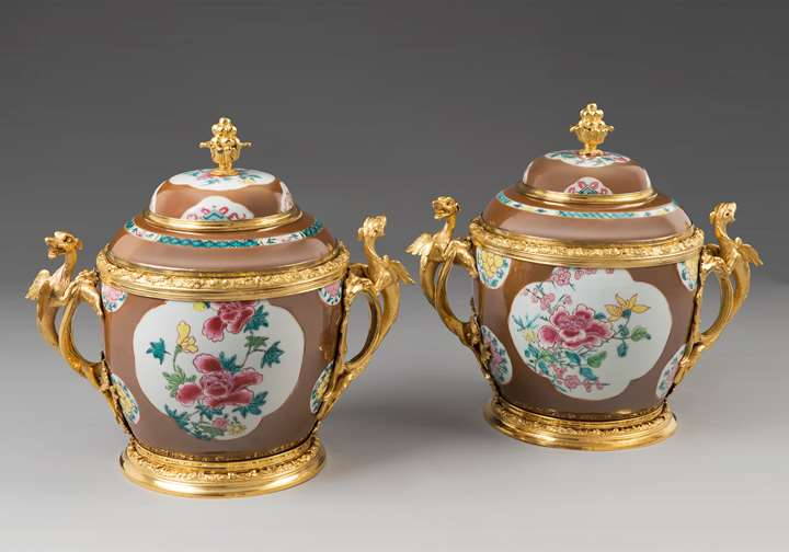 A pair of ormolu mounted lidded vases with capuchin-brown ground
