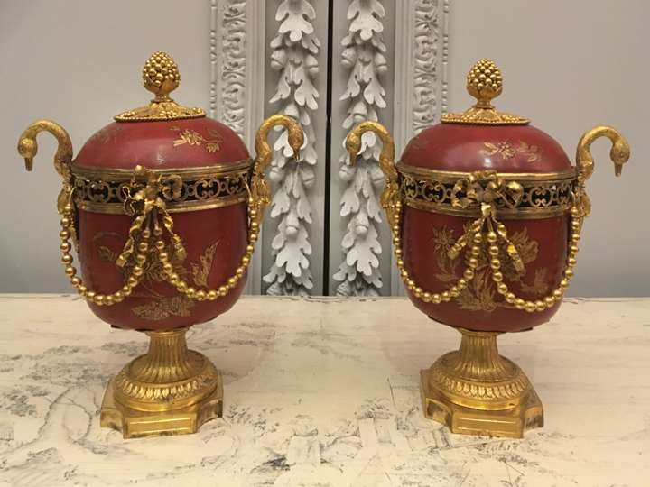 A pair of ormolu-mounted red lacquer potpourri vases with swan handles