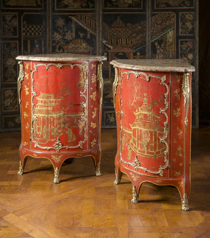 A pair of red lacquer encoignures