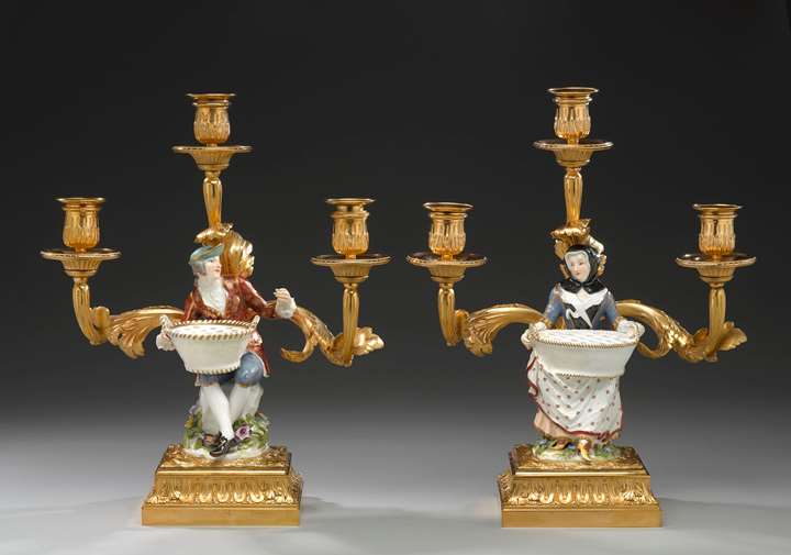 A pair of three branch candelabra with 'bouquetière' figures