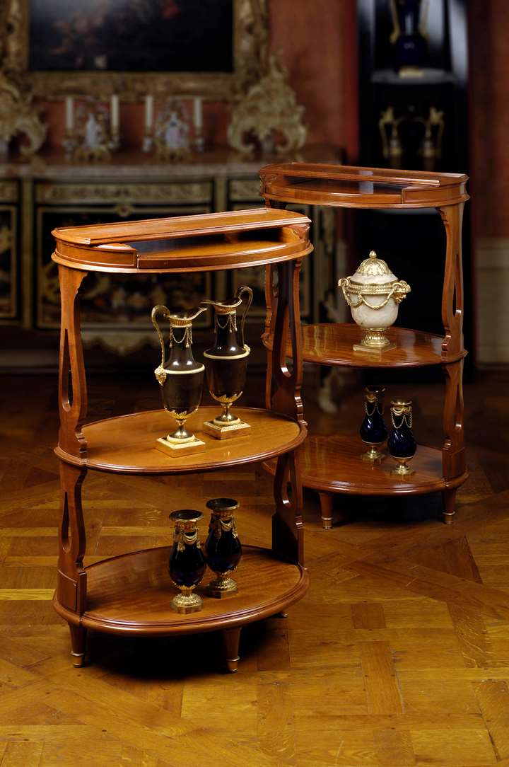A pair of three-shelf dessert tables