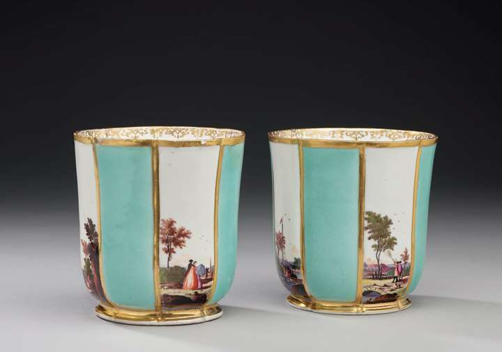 A pair of torquoise ground cachepots with landscapes