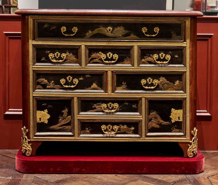 A rare and early black lacquer commode incorporating a ten-drawer lacquer cabinet