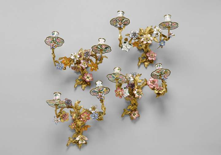 A set of four twin-branch Rococo enamel wall lights
