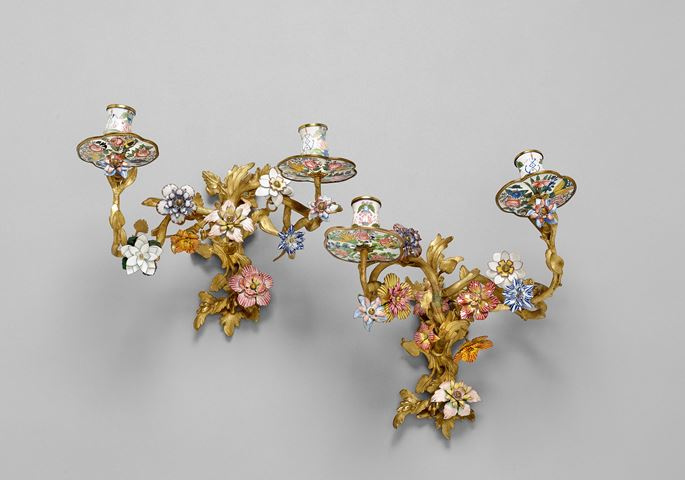 A set of four twin-branch Rococo enamel wall lights | MasterArt
