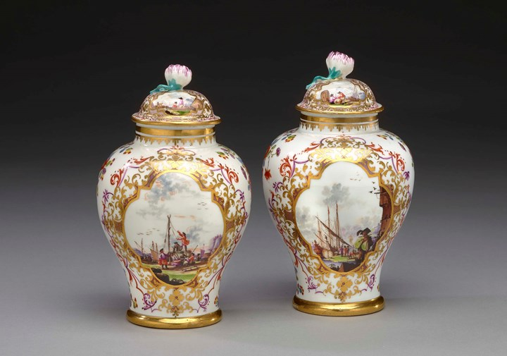 A pair of covered vases with polychrome harbour scenes