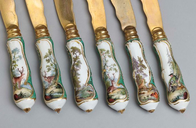 A cutlery set for six persons, decorated with hunting scenes and green-mosaic ground in its original leather case  | MasterArt