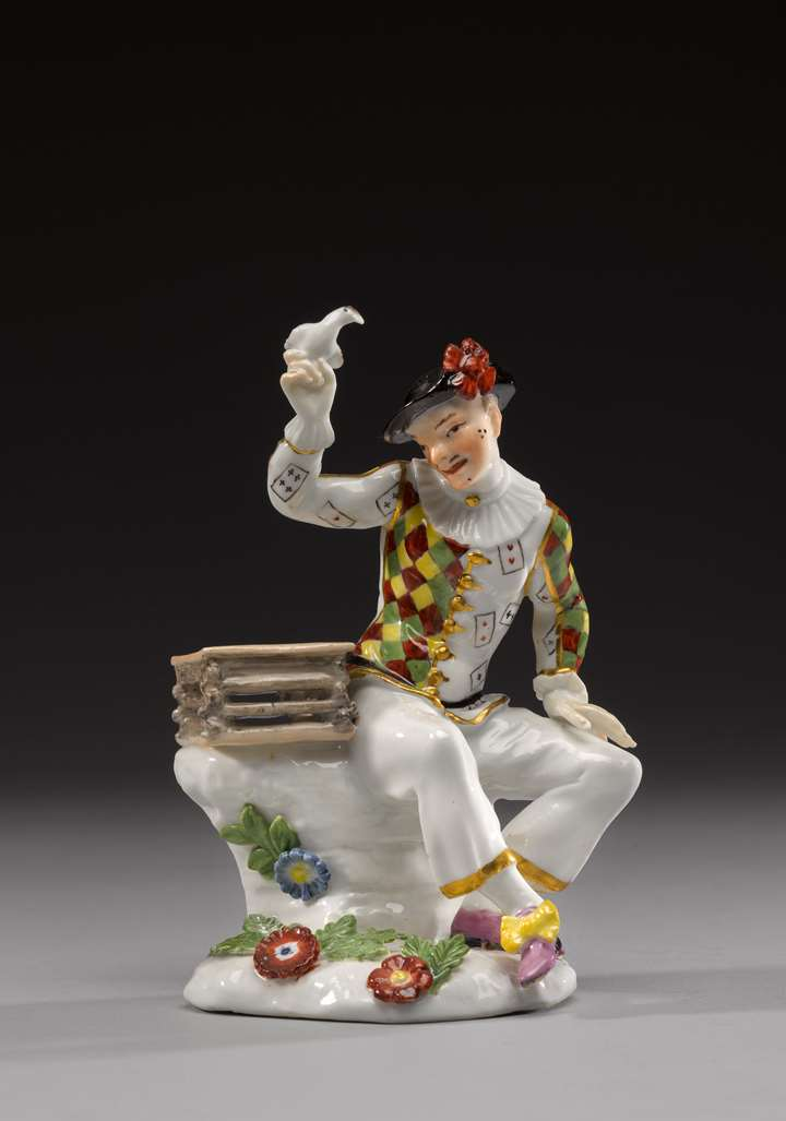 Harlequin with a birdcage