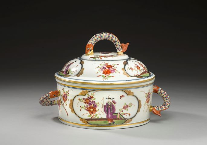 Johann Ehrenfried Stadler - A large covered tureen with fish handles decorated with polychrome chinoiserie scenes  | MasterArt