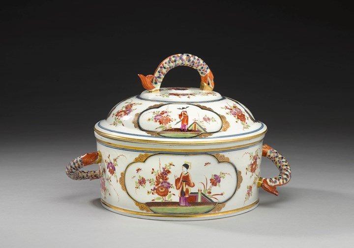 A large covered tureen with fish handles decorated with polychrome chinoiserie scenes