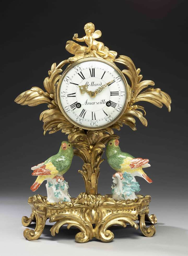 A gilt-bronze pendulum clock with two Meissen parrots