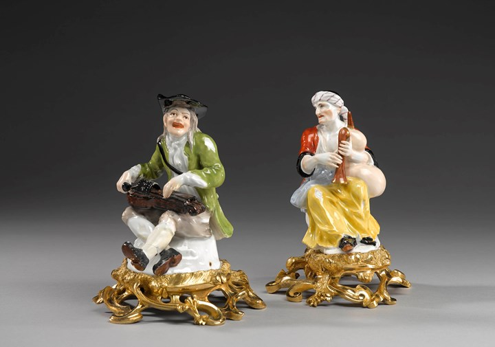 A pair of ormolu mounted beggar musicians