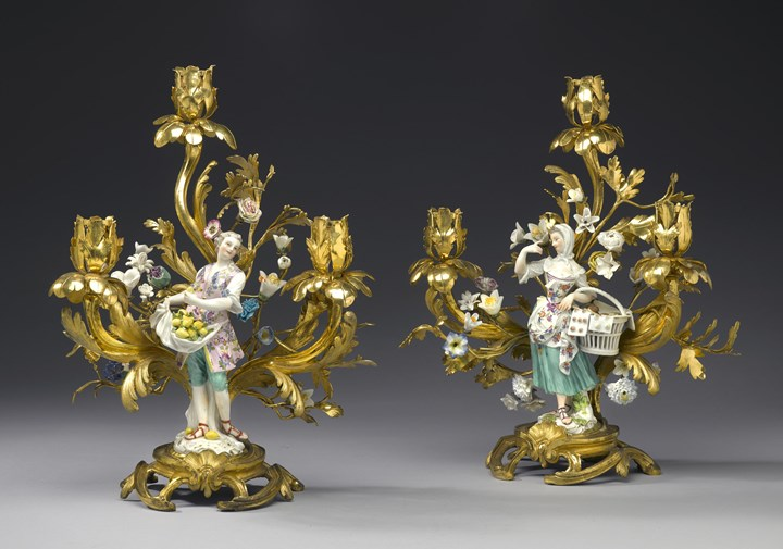 "Two figures of the series of the ""Cris de Paris""  mounted as three-branch candelabra"