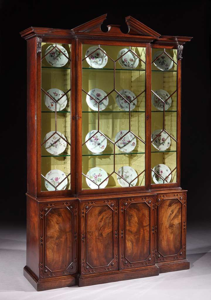 A GEORGE II MAHOGANY BREAKFRONT BOOKCASE