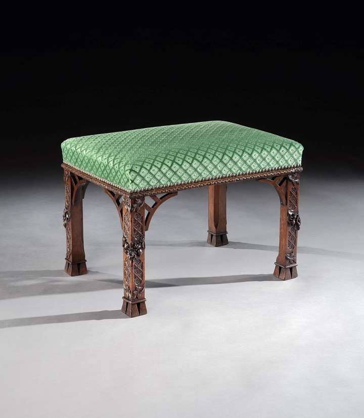A GEORGE II WALNUT STOOL