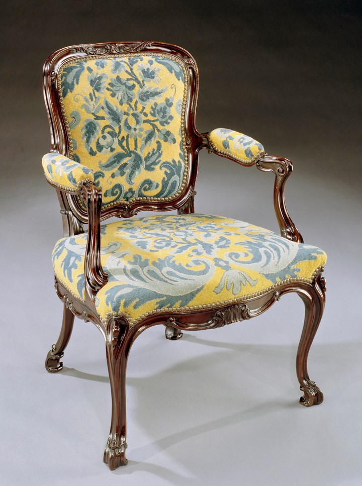 A GEORGE III CARVED MAHOGANY NEEDLEWORK ARMCHAIR