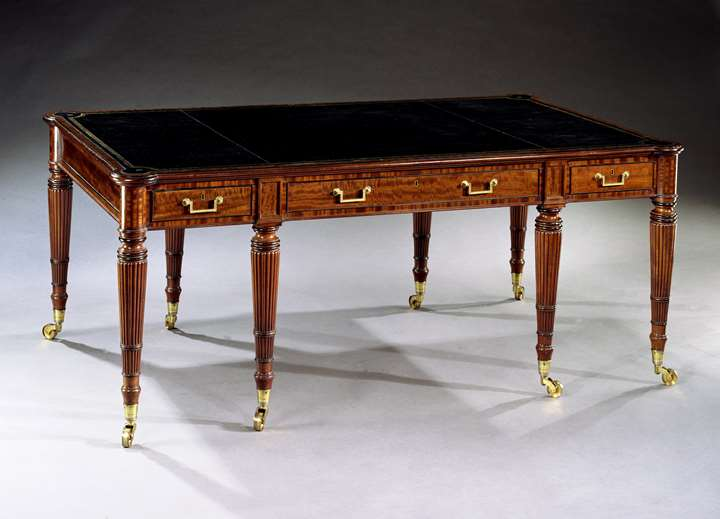 A REGENCY MAHOGANY LIBRARY TABLE
