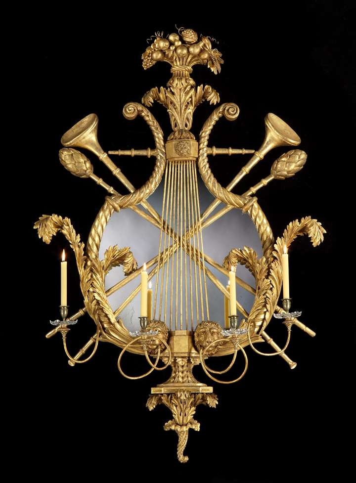 A MASSIVE CONTINENTAL REGENCY PERIOD GILTWOOD FOUR LIGHT GIRANDOLE