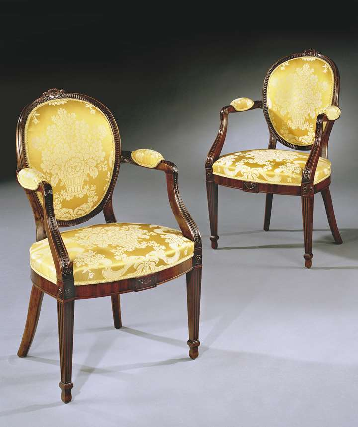 A PAIR OF GEORGE III MAHOGANY ARMCHAIRS