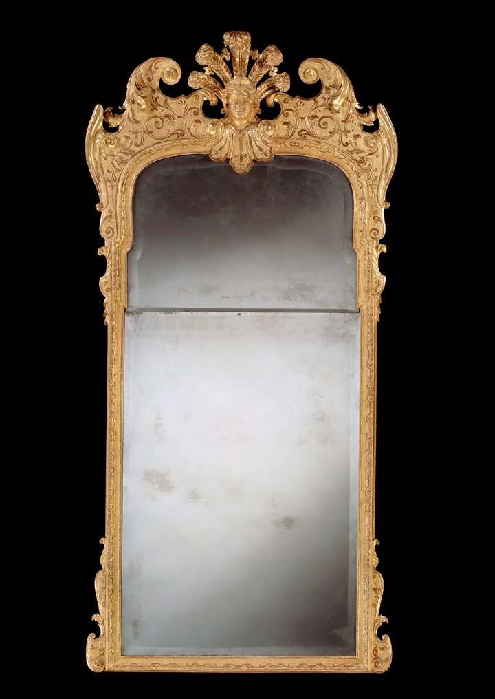 A GEORGE I GILTWOOD PIER GLASS
