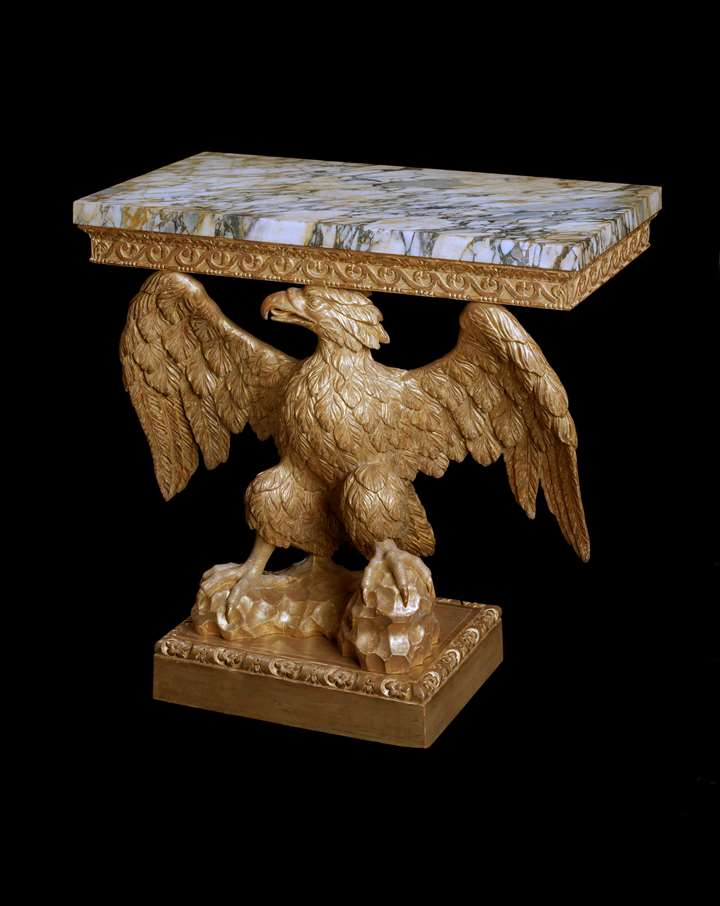 A GEORGE II GILTWOOD EAGLE CONSOLE TABLE