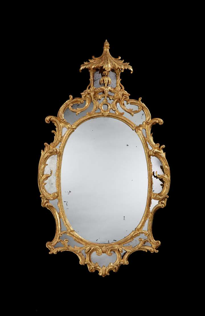 A GEORGE II GILTWOOD OVAL BORDER GLASS MIRROR