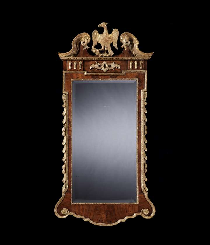 A GEORGE II PARCEL GILT WALNUT MIRROR