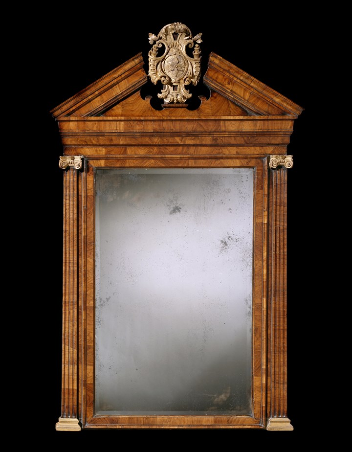A GEORGE II WALNUT AND PARCEL GILT MIRROR