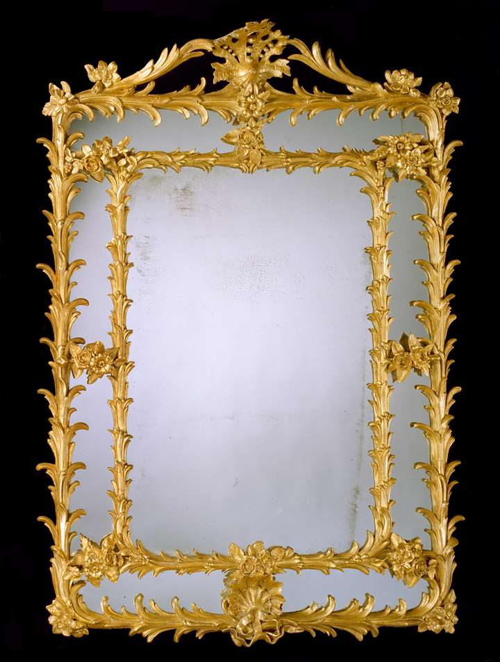 A GEORGE III GILT 'COMPOSITION' BORDER GLASS MIRROR