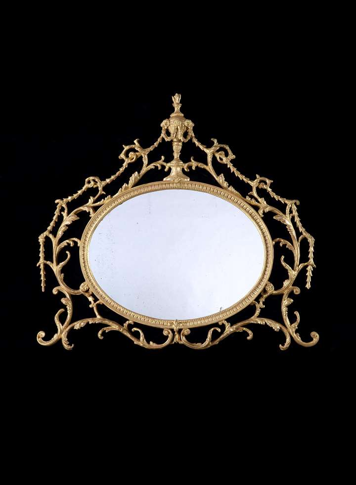 A GEORGE III GILTWOOD AND CARTON PIERRE OVERMANTEL MIRROR