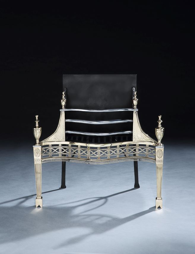 A GEORGE III GUN METAL AND CAST IRON FIRE GRATE  | MasterArt