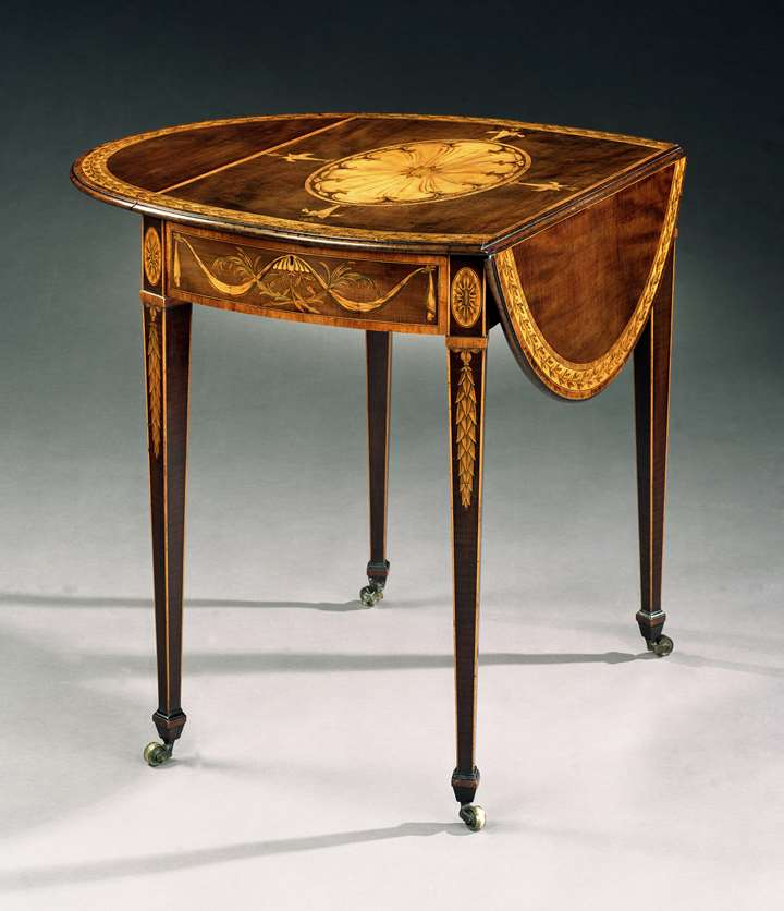 A GEORGE III HAREWOOD OVAL PEMBROKE TABLE