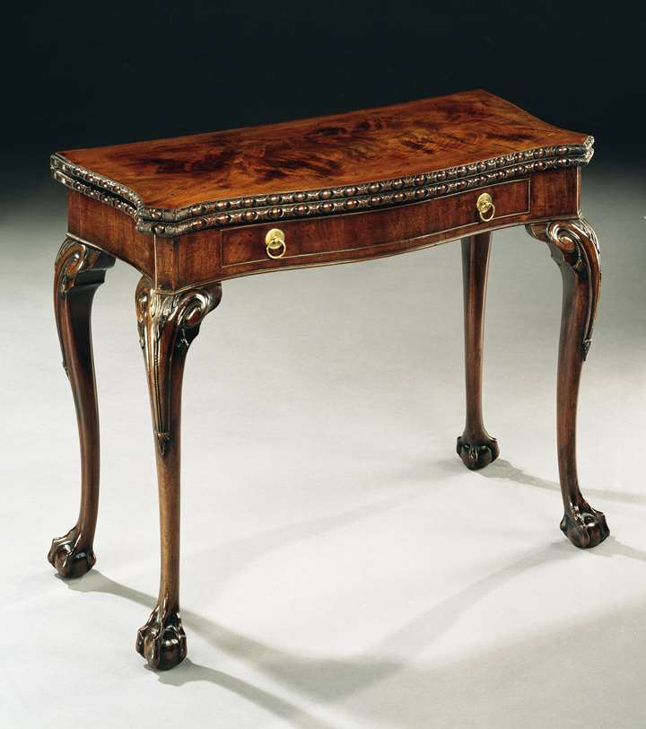 A GEORGE III MAHOGANY CARD TABLE