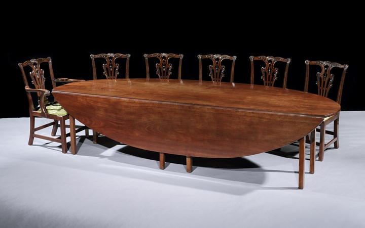 A GEORGE III MAHOGANY DROP-LEAF TABLE OF HUGE PROPORTION