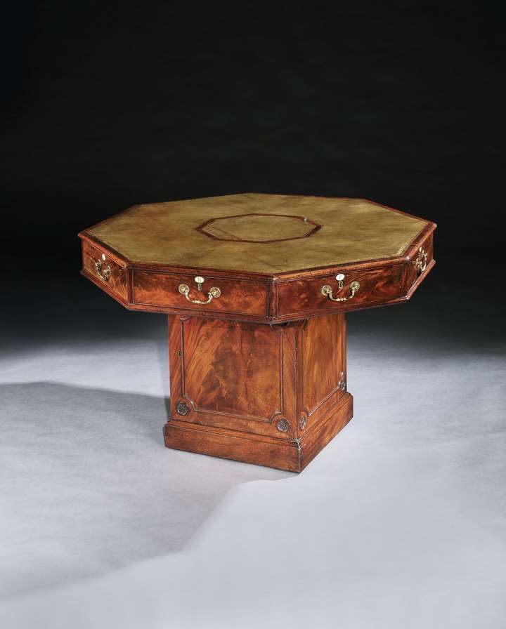 A GEORGE III MAHOGANY OCTAGONAL RENT TABLE IN THE MANNER OF THOMAS CHIPPENDALE