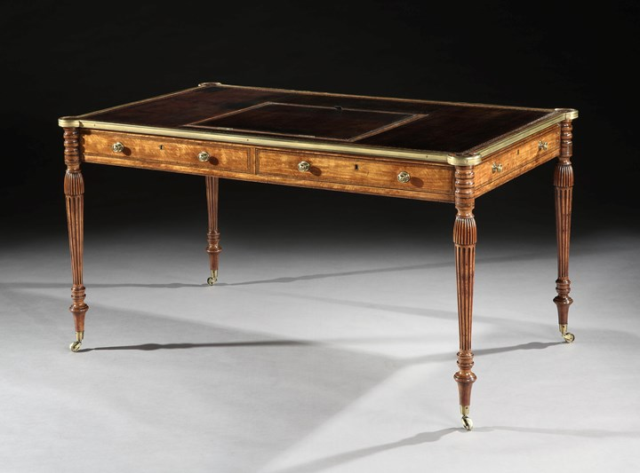 A GEORGE III SATINWOOD BRASS MOUNTED WRITING TABLE
