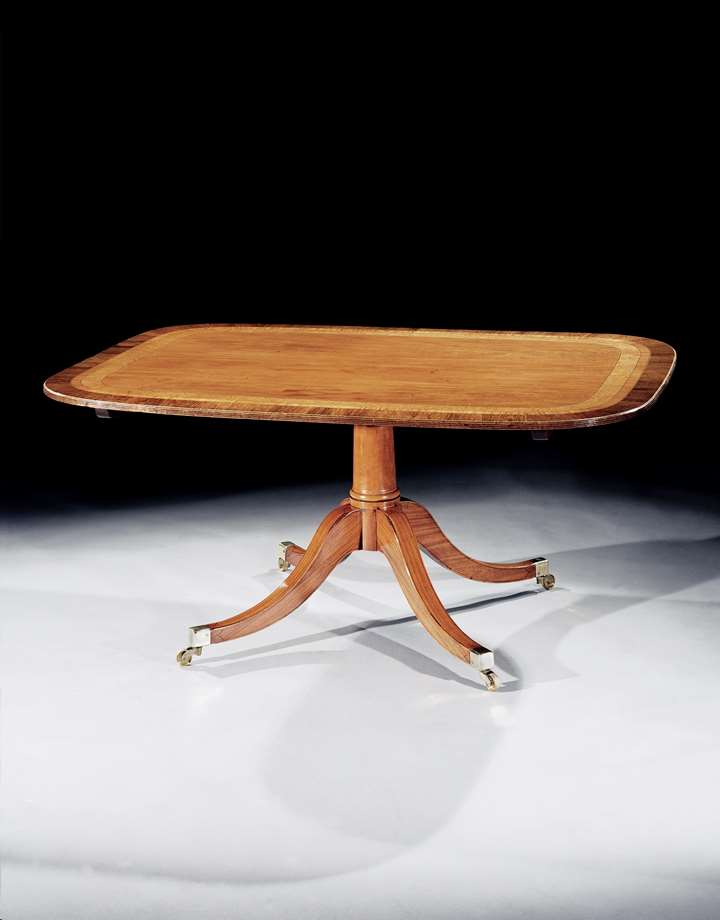 A GEORGE III SATINWOOD BREAKFAST TABLE