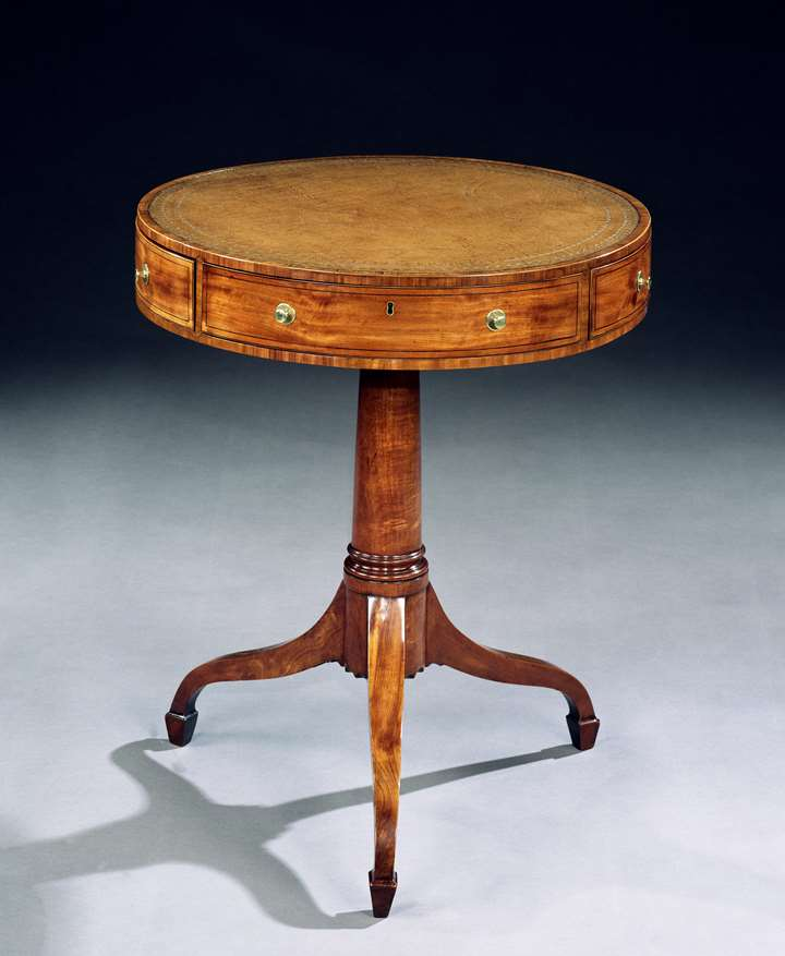 A GEORGE III SATINWOOD DRUM TABLE CROSS BANDED IN TULIPWOOD