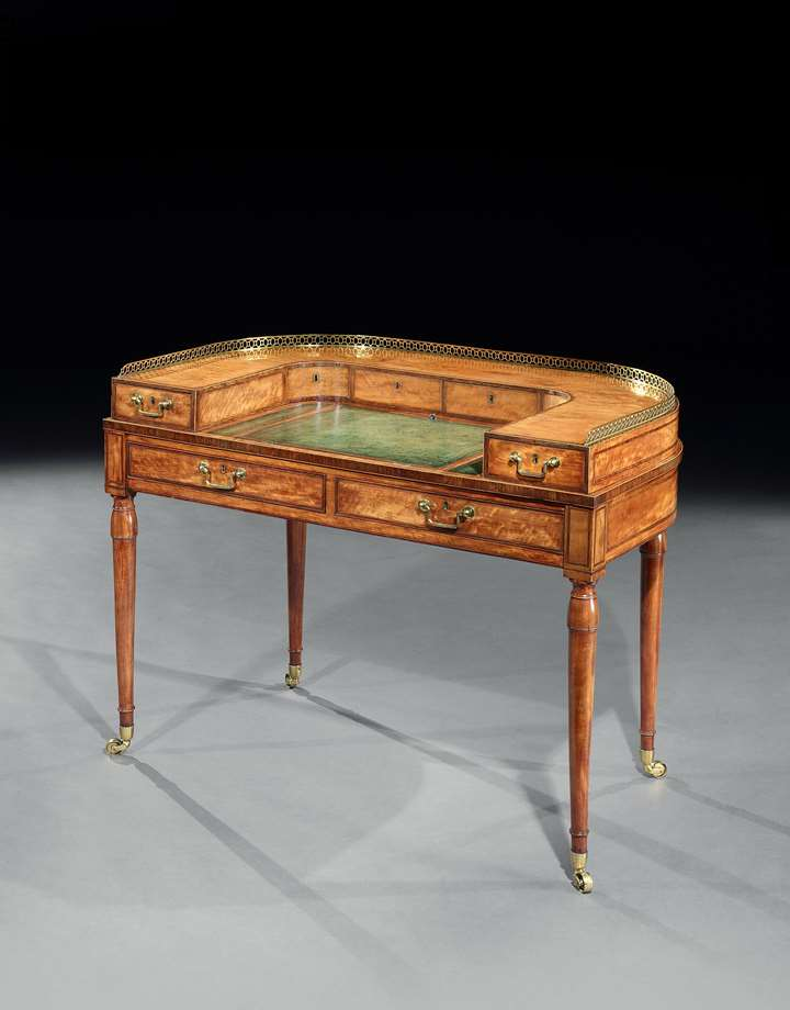 A George III small satinwood Carlton house writing table attributed to Gillows