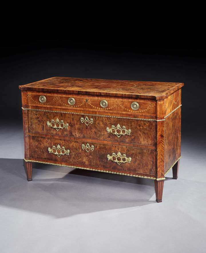 A GEORGE III YEW WOOD COMMODE