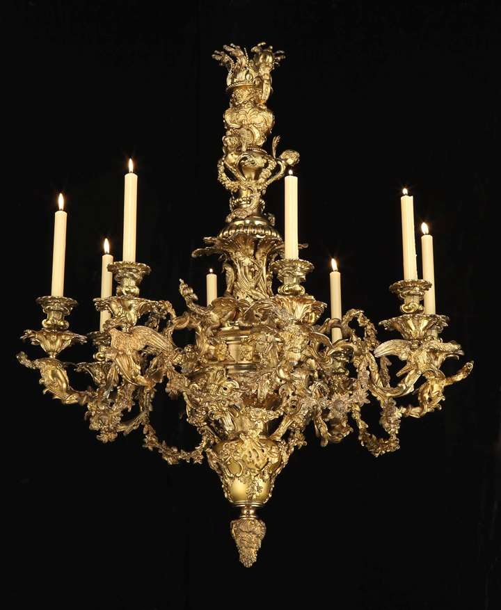 A GEORGE IV EIGHT LIGHT BRASS CHANDELIER