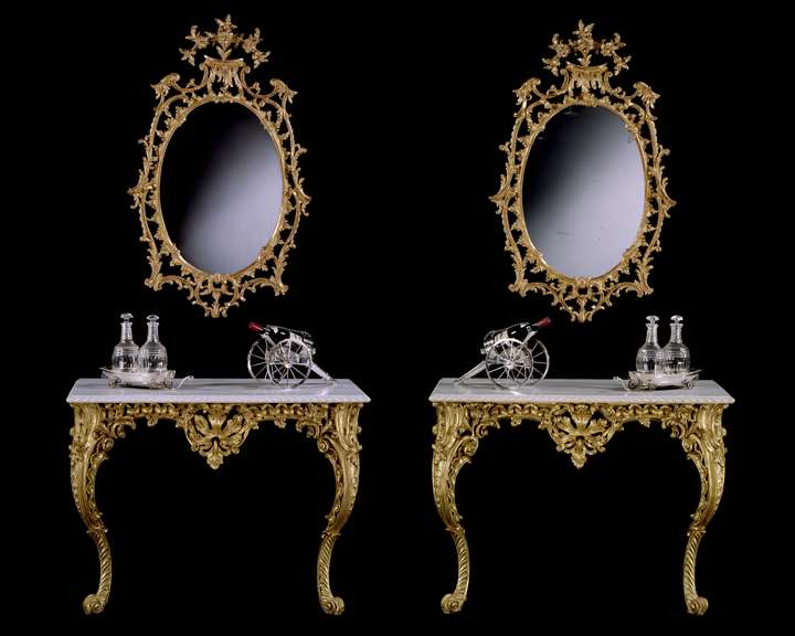 A PAIR OF GEORGE II CARVED GILTWOOD CONSOLE TABLES