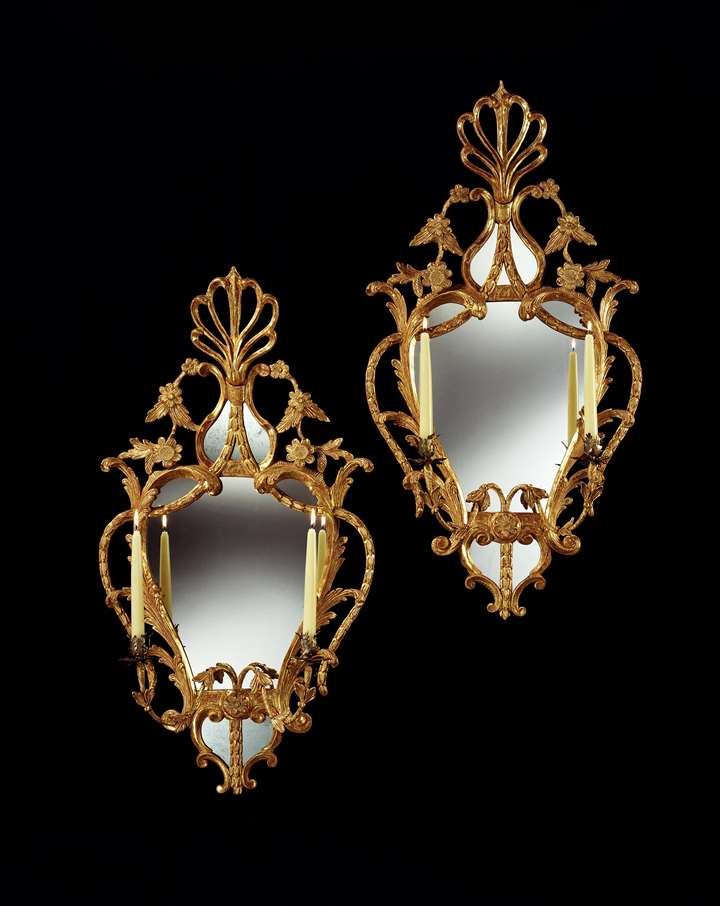 A PAIR OF GEORGE III CARVED GILTWOOD GIRANDOLES