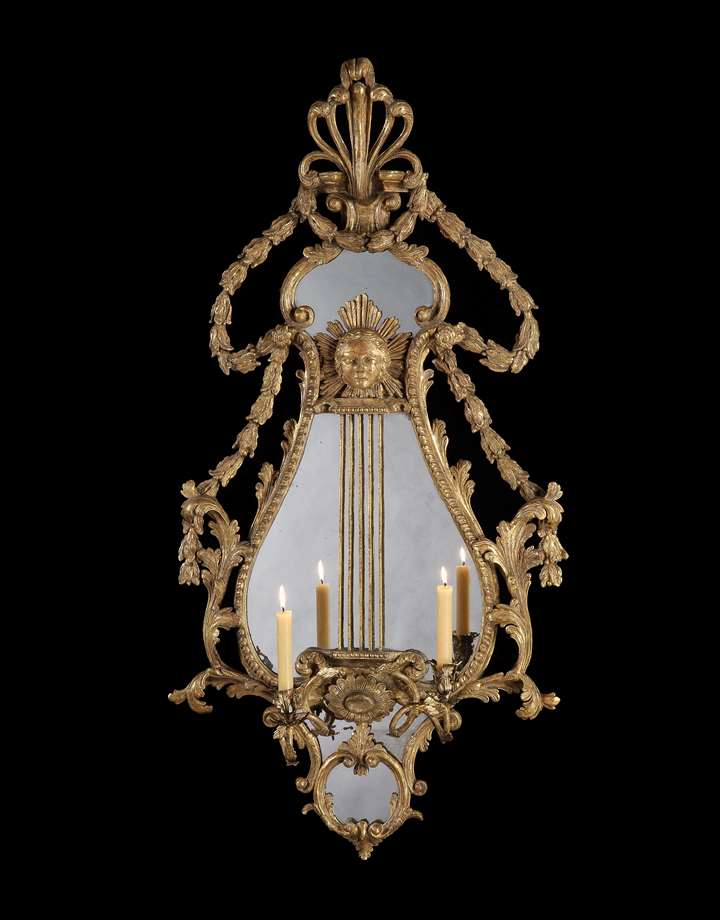 A PAIR OF GEORGE III GILTWOOD AND COMPOSITION GIRANDOLES AFTER A DESIGN BY JOHN LINNELL